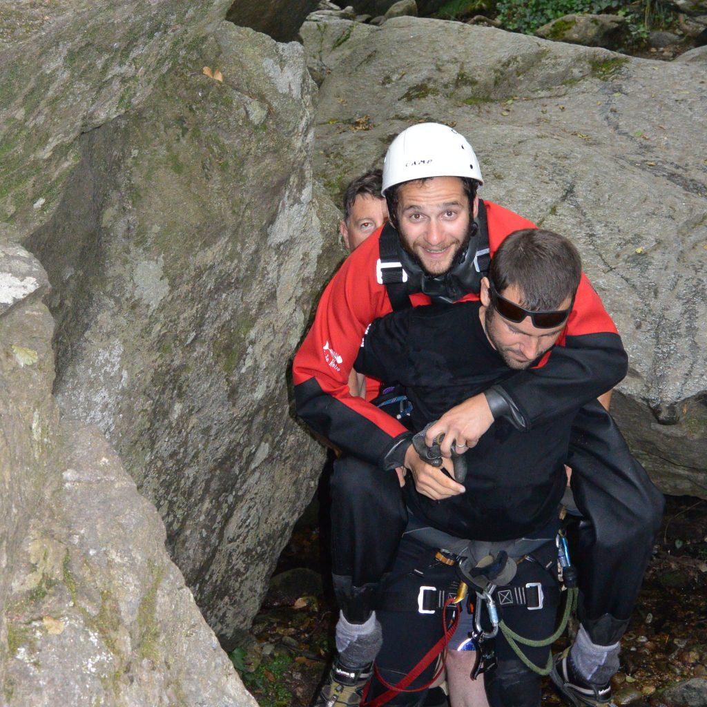 portage paraplegique en canyon au moyen de la sellette handi